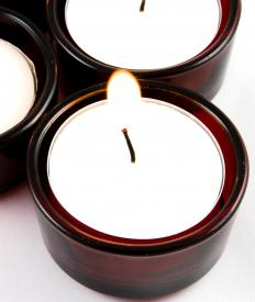 Votive candles might be placed in sconces to improve a room's ambiance.