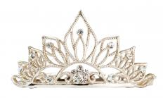Swarovski crystals may be featured on tiaras.