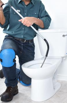 A plumber might need to use a drain snake to unclog a toilet.