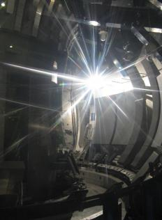 Tokamak fusion reactors, which are being researched in several countries, may be able to use donut-shaped chambers that are lined with powerful magnets to contain fusion reactions.