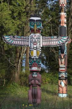 Totem poles, which are associated with the Native Americans of the Pacific Northwest, are carved posts that display symbolic figures.