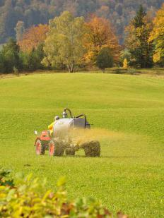 A farmer spreading nitrogen fertilizer.