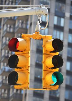 With color blindness, red and green traffic lights might look like the same color.