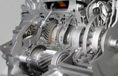 A car's transmission is the part of the powertrain that transfers mechanical energy from the engine to the drive shaft.