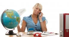 A travel agent making arrangements for a client.