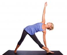 The Triangle Pose, a popular yoga move, is also suitable during warm-ups at the gym.