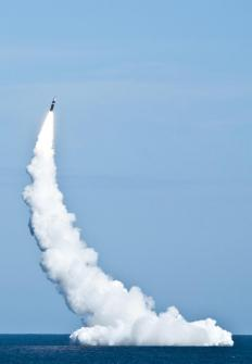 Some Naval submarines, such as the Ohio-class submarines, can fire Trident missiles that use kinetic energy technology.