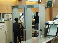 Someone held at airport security without evidence of terrorism activity might be a type of unlawful detainment.