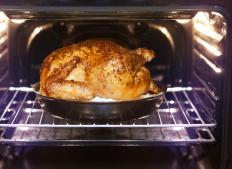 A turkey breast may be thawed in the oven, but it will take a considerable amount of time.