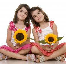 Girls holding sunflowers.