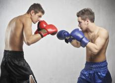 Boxing gloves protect fighters' hands as they throw punches.