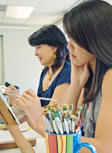 Many people enroll in art classes, learning skills such as painting.