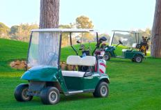 A golf cart is a small motor vehicle that's driven around golf courses and other enclosed areas.