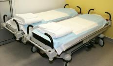 Hospital bed mattresses are typically thin, but designed to support bed-bound patients.