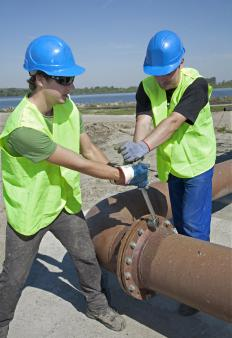 Corrosion technicians inspect and repair metal pipelines.