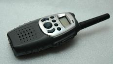 A PMR walkie talkie allows bidirectional communication.