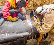 In the type of arc welding often used on pipes, flux creates a gas shield for the site aiding in bonding the metals.