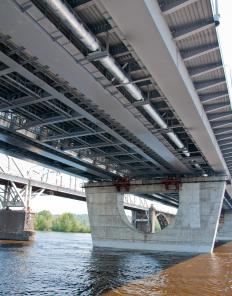 Structural beams are used in bridge creation.