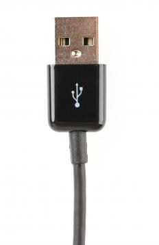 A USB cable connects a USB smart card reader to a computer.