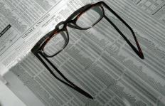 Reading glasses may be purchased at a drugstore.
