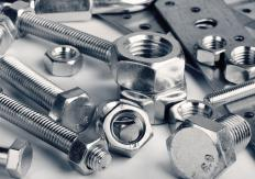 An expansion bolt is comprised of a bolt, nut, and lead sleeve assembly that expands upon tightening.
