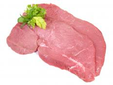 Raw veal chops.