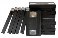No direct adapters can be used between VHS cassettes and 8mm film.