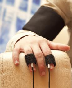 The perspiration on a person's fingertips is evaluated during a polygraph test.