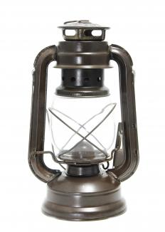 Hurricane lamps, or lanterns, are enclosed to shield the flame from the wind.