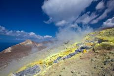 Sulfur and sulfur-based compounds are released by volcanic activity.