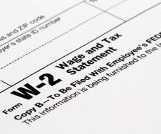 A W-2 form reports wages, taxes withheld, and Social Security and Medicare taxes.