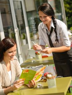 The stereotypical day job of an aspiring act is waiting tables.