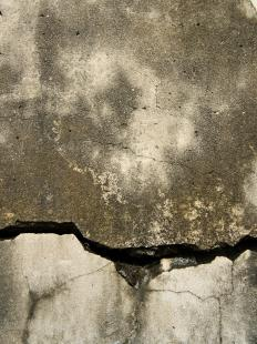A cracked concrete walkway in need of repair.