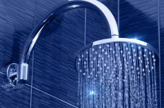 Copper, carbon and zinc are common types of filtering materials used in shower head water softeners.