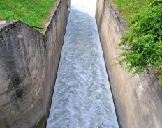 A penstock is designed to regulate the flow of water that is released.