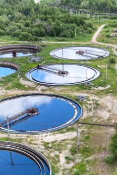 Settling tanks are used at water treatment facilities to filter out the smaller contaminants from the water.
