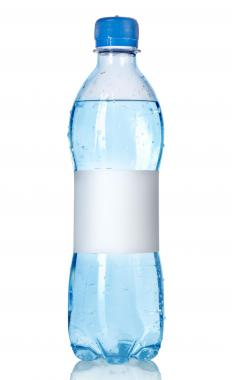 Drinking lots of bottled water in order to stay hydrated is important when preparing to run a marathon.