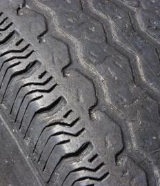 "A tire's tread will eventually become worn, thinning to the point of being ""bald."""