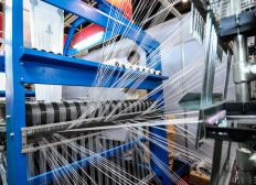 A weaving machine can be programed to create a specific type of carpet.