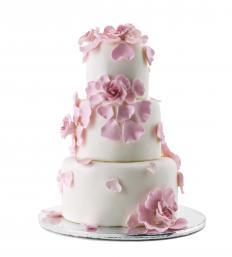 Fondant, which is edible, is often used to cover the wedding cake.