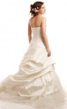 Many brides opt to wear a bustle at their wedding reception so that they don't ruin their dress.