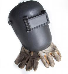 Welders should wear helmets and gloves for protection.