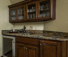 An undermount bar sink may be featured with a wet bar.