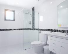 Wall-mounted bathroom vanities typically feature a faucet and sink with a storage area underneath.