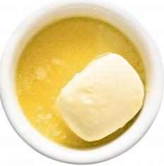 Flour is added to melted butter to make beurre manié.