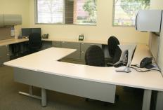 Some swivel desk chairs are made as part of a set of modular office furniture.