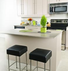 A breakfast bar with stools could be a good choice for a client-oriented kitchen.
