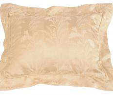 A pillow with a pillow sham.
