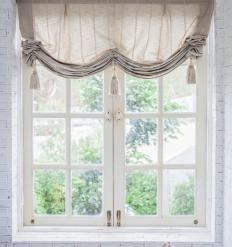 Bedroom window treatments may match other design elements in the room.