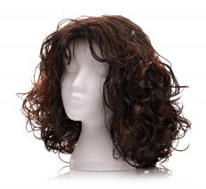 A wig cap provides a surface on which a wig can be placed.